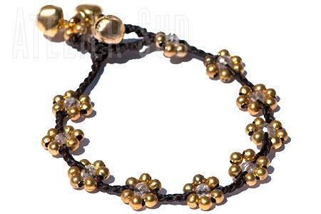Gevlochten katoen met goudkleurige kraaltjes, grijs koord met zilverkleur en facet geslepen smokey kleurig kristalglas