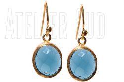 handgemaakte oorbellen met London Blue Topaasedelstenen